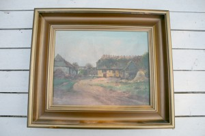 Maleri i ramme med landligt motiv.